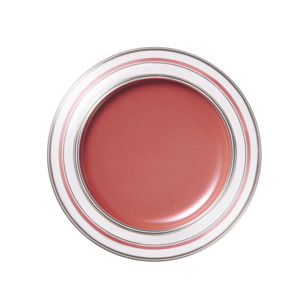 A magnified image of the texture of the Limited Edition Cream Blush, Warmth's Magic