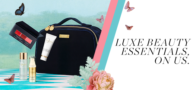 LUXE BEAUTY ESSENTIALS, ON US. This exquisite four-piece set is yours along with a limited-edition holiday travel bag when you spend 300美元 or more.